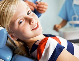 Young girl in dental exam chair