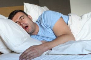 man asleep drooling on pillow