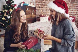 woman smiling wearing red santa hat